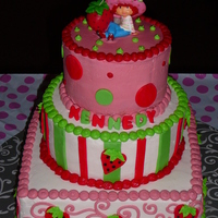 Strawberry Shortcake this is a 3 tier buttercream base icing and all fondant accents