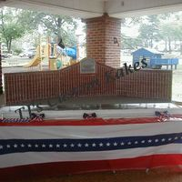 "Veteran's Memorial  Single Tier, 8' long, White Cake. The brick wall was made from styrofoam sheets, 2"" thick, completely iced in royal icing, then..."