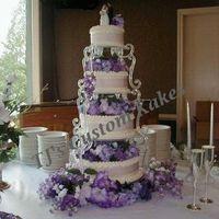 Victorian Lavendar 4 Tier, 14, 12, 10,& 6. Almond cake w/White Buttercream. Lavendar Silks w/Light Lavenrdar Ribbon around Tiers.