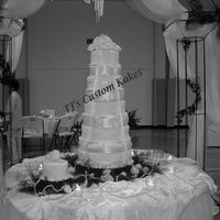 Rorex Satin  6 Tiers, 16, 14, 12, 10, 8, 6. Fondant/w/Satin Pillow inserts.Almond Cake, White, Satin-ice Fondant. White Roses as a base and Topper. The...