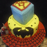 Superhero Cake Two tiered buttercreme frosted WASC. Spiderman bottom cake board, frosted and piped with webbing detail. Center cake Batman, freehanded...