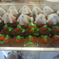 Ghosts In A Pumpkin Patch Devil's food cupcakes with MMF ghost toppers and mallow pumpkins. For a large Halloween Party.