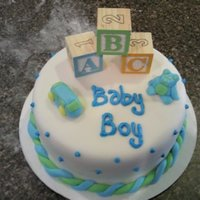 Boy Baby Shower   White Boxed cake, homemade Buttercream Fondant, real blocks and sculpted fondant/gumpaste figures.