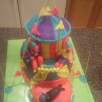 Gilry Bigtop Circus Cake 2nd attempt at building a cake. For a little girl's birthday. Homemade butttercream fondant, boxed yellow cake, settling occurred. 14...