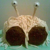 Flying Spaghetti Monster The FSM has landed! This was a chocolate cake with fondant and marzipan noodles.