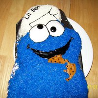 Cookie Monster used wilton pan. made it with butter cream icing and the cookie I made with fondant to make it look more real