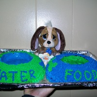 Puppy Cake My daughter had a puppy party so I made a food and water bowl. She wanted blue M & M's for water and Reese pieces for food. She...