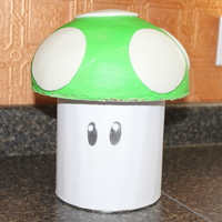 Super Mario One Up Mushroom I am 11 years old... This is my 3rd professional cake for my new cake business. Cake is the 1/2 circle on the top. Iced with buttercream...