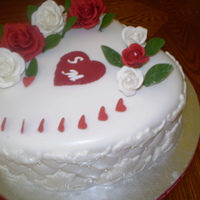 Happy Valentine's Day This cake was made for a client, who was celebrating her 22 wedding anniversary on Valentine's Day. The cake is red velvet with cream...
