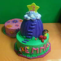 Dora Star Mountain Cake Dora and Boots having a party on Star Mountain! The cake is confetti cake with vanilla butter cream. Flowers and star are fondant. The...