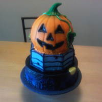 Halloween Cake 2010 Tiered Halloween cake made for a competition. The bottom tier is chocolate cake with vanilla buttercream, the middle tier is cinnamon with...