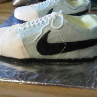 Nike Shoes Cake shoes made with vanilla cakea and vailla butter cream. I was very excited about this cake because it was my first carved cake. Hope...