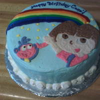 Dora And Boots!! A friend of mine wanted a Dora cake for her daughter's first birthday so this is what we came up with. Its a marble cake with a...