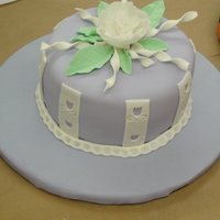 Wilton Fondant And Gumpaste 2Nd Cake My daughter accompanied me to most of my classes during this course, therefore, I made her happy and made my last cake purple, her favorite...