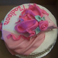 "Ballet Slipper A cake for a ballet fan. The 9"" round cake has a fondant covered pillow on it detailed with small pearls and accent with a fondant..."