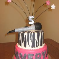 Music Cake   Buttercream iced cake with fondant letters/microphone.