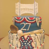 World Series Themed Yankee Cake BC cake with fondant pennants, bat, ball, glove and facade.