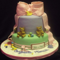 Teddy Bear Baby Shower Cake Bottom Tier is White Almond cake with Raspberry BC and Top Tier is Yellow Butter cake with Vanilla BC. This was my first time makling...