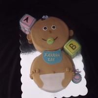 "Baby Cake This is a baby shower cake I made from a request. 2 8"" round cakes covered in fondant with gumpaste accessories. Baby blocks and..."