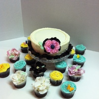 "Anenome Flower Cake And Cupcakes 8"" round yellow butter cake with Chocolate cupcakes. This cake was made for the Women's Homeless Shelter.... WE really enjoyed..."