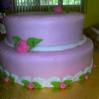 Marta Pink fondant with buttercream and rum cake.