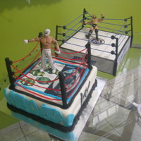 Lucha Libre This cake has 4 wooded dowels covered in black fondant, then I used twizzler candy to make the rope this was so hard to make them stick...