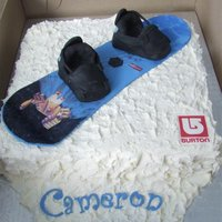 Burton Snowboard Snowboard cake to look like the birthday boy's. Snow part is chocolate cake with oreo filling, snowboard is fondant and boots are rice...