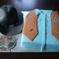 Walker Texas Ranger Cake and hat are chocolate cake with chocolate cream cheese filling.. Hat brim is gumpaste. Inspired by Walker, Texas Ranger...recipient is...