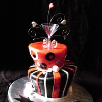Fun Topsy Turvy For a 30th Birthday...My 1st time doing topsy turvy!! Theme was Red, Black and Silver...but it looks white in the picture due to my 1 yr....