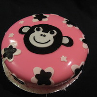 Monkey Cake Pink and brown fondant with a coconut trim.