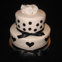 Black And White Fondant And Ribbon Cake Black and White Fondat hearts and dots with Black Silk Ribbon topped with white fondant roses