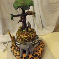 Jungle / Rainforest Cake With Chocolate Tree Jungle/ rainforest cake with gumpaste animals and a chocolate tree.. everything is edible except a few wooden dowels and a peice if wire...