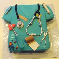 Nurse Scrubs Cake W/ Edible Instruments Nurse cake March 21, 2010 Nurse cake March 21, 2010this ENTIRE cake is edible!Items on cake are: tweezers,stethoscope,syringe,scissors,...