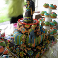 Bohemian Hippie Wedding W/ Gumpaste Family Of 7 My very first wedding cake for my very special freind . In addition to the cake, I made the Bride, Groom, and all 5 of thier children, out...