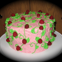 Raspberry Garden  A white cake with raspberries baked into it, filled and iced with raspberry italian meringue buttercream, decorated with vines, leaves, and...