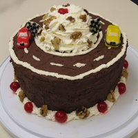 Sundae Race Track An ice cream sundae in cake form, including the whipped cream and cherry on top. The top is a race track with marzipan cars on it (one is a...