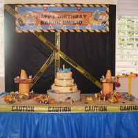 Construction Cake This is my grandson Baruk first birthday cake. The theme was construction, all on it can be eaten. The floor is dark sugar, scene was a...