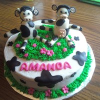 A Cake Just For Moo   chocolate cake with raspberry filling and chocolate ganache. customer wanted a cow theme so i made them out of gumpaste.