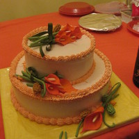 My Mother's 83Rd Birthday Cake dominican cake with pinapple filling. calla lilly flowers made out of gum paste.