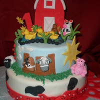 Little Farm Cake Pound cake with vanilla filling and fondant covering. All decorations (animals) are edible.