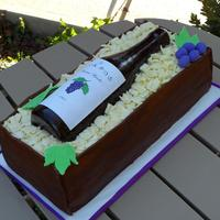 Wine Bottle  Chocolate cake, chocolate icing, chocolate fondant, with white chocolate shavings. Everything is edible but the label. Just wanted to make...