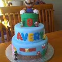Super Mario Brothers Cake for my daughter's 8th birthday, Inspiration from debi1976 and JennS. Mario is RKT covered in modelling chocolate. Decorations are...