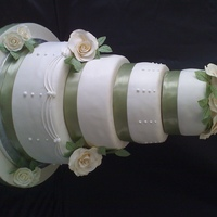 Ivory Roses Cake is all white with strawberries and cream filling. Covered in white Satin Ice fondant and decorated with Ivory gumpaste roses, satin...