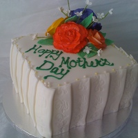 Mother's Day Floral  White cake with coconut buttercream filling. Gumpaste roses are airbrushed then handpainted with highlights. Pleating around the cake is...
