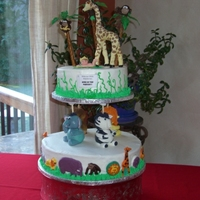 King Of The Nursery  Buttercream cake, animals were created using rice crispies, then wrapped in fondant. The baby was sculpted MANUALLY before I knew there is...
