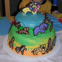 Animal Birthday Cake   my son's first birthday cake. animals are made from candy melts.
