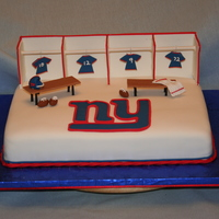 New York Giants Fan   9x13 cake covered with fondant. Made lockers, benches, Logo, football, helmet and jerseys out of tylose paste.