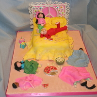Slumber Party Cake  Yellow cake covered with buttercream the fondant for the spread. The headboard was made of gumpaste. All figures were made of tylose paste...
