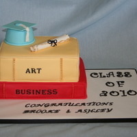 Graduation Cake  Yellow and chocolate cakes covered in fondant to make look like books. Cap was a small wonder pan with the top cut off. Made the diploma...