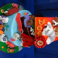 Dog Lover # layers turvycake with diferent kinds of dogs made with ricekrispies treats ,fondant and gumpaste